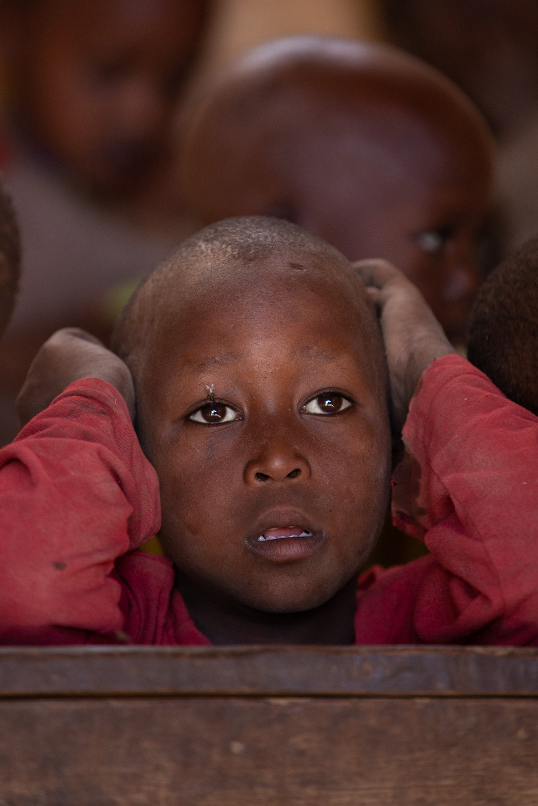 Boy in school in a Massai village in Tanzania