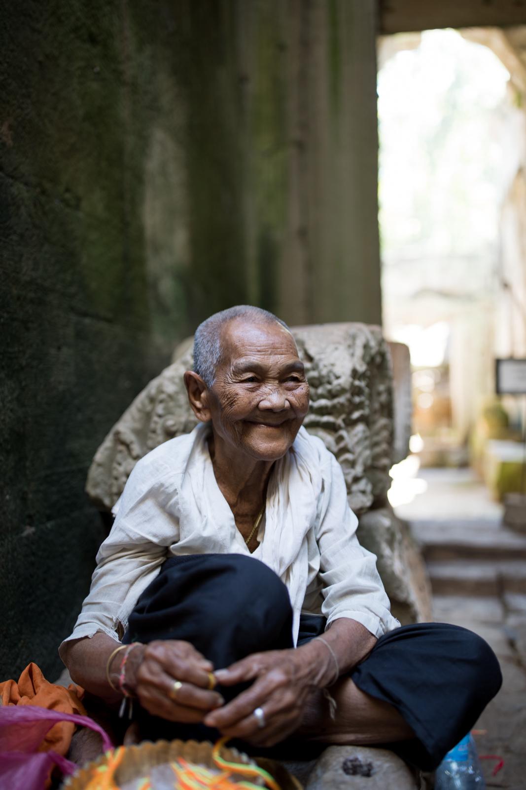 Spirituel woman working around Angkor Wat